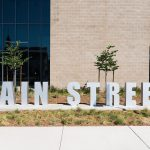 "image that shows the ""Main Street"" sign outside of the new school"